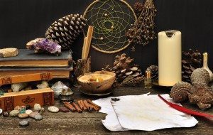 Learning Witchcraft tools. Old books, candle, stones pine cones and a piece of paper